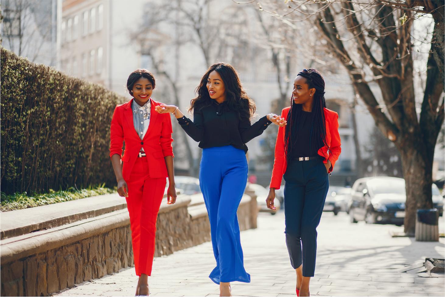 3 Professional black women walking down the street.